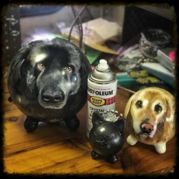 Two Painted Dog Cremation Urns
